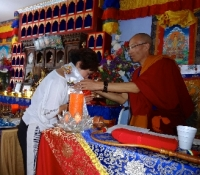 Nancy Tong, CEO of YYEF, presents Lama Youngtong Tenzin a Haddha to express our respect.