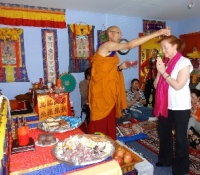 One by one, each pledger of the 40 Buddha statues receives individual blessings during the Empowerment ceremony.